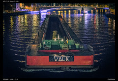 Valk - Night Barge (Falcdragon) Tags: sonya7alpha ilce7 sonyzeisssonnarfe1855mmza river meuse night barge rivertransport shipping nightphotography citylights
