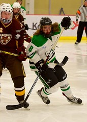 eyes on the puck (R.A. Killmer) Tags: sru ice hockey skate skill stick hits shot puck acha green white college competition gritty