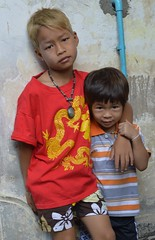 wistful looking boy and his friend (the foreign photographer - ฝรั่งถ่) Tags: wistful boy two boys chinese new years shirt red khlong thanon portraits bangkhen bangkok thailand nikon d3200