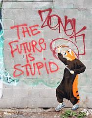 The Future is Stupid (Coastal Elite) Tags: future is stupid graffiti montreal streetart plateau street art pasteup wheatpaste red paint spray montréal zonek onesie hammer running shoes wall mur urban