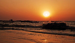 Surf and seaspray Arabian Sea (arfabita) Tags: ocean sunset red sea people orange sun playing color beach nature water colors silhouette yellow horizontal set sunrise landscape boats dawn boat fishing globe sand rocks surf waves glow sundown natural dusk sandy horizon relaxing orb tourists rockface spray boulders hues canoes environment glowing leisure recreation rise enjoying pleasure atplay beautyspot vessels bouncing seaspray arabiansea horizonline roacks watiching nicescene atleisure beackcombers
