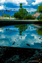 water-tower-reflection.jpg (r.nial.bradshaw) Tags: trees mountains reflection water clouds puddle photo nikon streetlights watertower pennsylvaniaavenue ogden stockphoto stockphotography attributionlicense ogdenutah nikond80 1870mmafs lightroom4 rnialbradshaw
