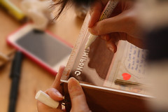 Jo, carefully writing (backwards!) on our wooden box display (the little drm store) Tags: school red roses birds typography fly high poem friendship graduation exhibition retro nostalgia nostalgic forgetmenot joanne lim autographbook