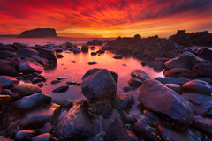 Minnamurra (stevoarnold) Tags: ocean red sea seascape clouds sunrise rocks purple australia nsw sunburst kiama minnamurra illawarra minnamurrariver