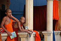 untitled (village near siem reap, cambodia) (bloodybee) Tags: boy orange asia cambodia religion monk buddhism monastery porch column siemreap