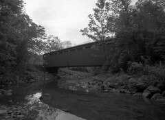 Everette Road Covered Bridge (.:Axle:.) Tags: park ohio bw usa film nature blackwhite nationalpark woods 645 natural pentax kodak tmax reserve hc110 historic waterfalls historical 6x45 forests cuyahogavalleynationalpark smalltowns cuyahogavalley pentax645 kodaktmax100 filmphotography 100tmx smcpentaxa64535mm135 believeinfilm