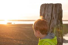 Golden hour (O.I.S.) Tags: wood boy sunset sea sky water deutschland tim kid holidays meer wasser sonnenuntergang child urlaub himmel kind northsea holz nordsee nordrheinwestfalen kste fhr lippstadt