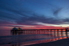 Malibu Pier (Pete Nunnery) Tags: ocean california blue winter sunset red sky orange color beach nature colors silhouette night clouds canon photography photo losangeles twilight flickr surf contrail shadows purple image cloudy ngc malibu southerncalifornia soe geodata thecolonymalibu