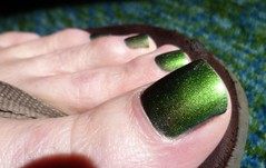 ST. Patty's Day - sparkly green closeup (toepaintguy) Tags: male guy men man masculine boy nail nails fingernail fingernails toenail toenails toe foot feet pedi pedicure sandal sandals polish lacquer gloss glossy shine shiny sexy fun daring allure gorgeous green st saint patrick color changer ilnp shimmer