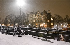 Snow flakes falling in the heart of Amsterdam (B℮n) Tags: amsterdam papiermolensluis brouwersgracht snow covered bikes bycicles holland netherlands canals winter cold wester church jordaan street anne frank house dutch people scooter gezellig cafés snowy snowfall atmosphere colorful windows walk walking bike cozy boat light rembrandt water canal weather cool sunset celcius mokum pakhuis grachtengordel unesco world heritage sled sleding slee seagull meeuw bycicle 1°c sun shadows sneeuw brug slippery glad night flakes evening handheld seat bankje fairytale mist prinsengracht 50faves topf50 100faves topf100