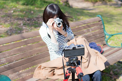 Taking a picture of my wife takes picture of my film camera (Arbit Bamboo0101) Tags: spring 30mm art sigma old wife film new garden om1 canoneos love bench olympus camera portrait park family osaka kissx7 omd em10 markii omdem10markii