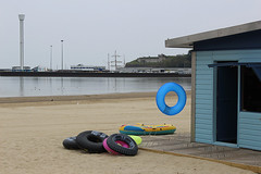 My London Street Photo workshop this Saturday - see my blog (via website) for details (Paul Russell99) Tags: weymouth seaside beach inflatables rubber ring sea sand hut tower