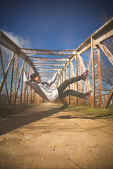 Gravity (Isma Yunta) Tags: gravity levitation people fly air boy street outdoor visual bookeh depth portrait creative