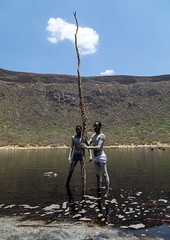 Volcano crater where Borana tribe men dive to collect salt, Oromia, El Sod, Ethiopia (Eric Lafforgue) Tags: adultsonly africa african blackpeople borana caldera colourpicture country crater danger dangerous day developingcountry elsod ethiopia ethiopia0317031 ethiopian extinctvolcano fulllenght geographic geography hardwork hornofafrica lake landscape men menonly naturalphenomenon oromia oromiya oromo oromya outdoors realpeople resources saline salt saltlake sod stick tribe twopeople vertical volcanic volcano water workers