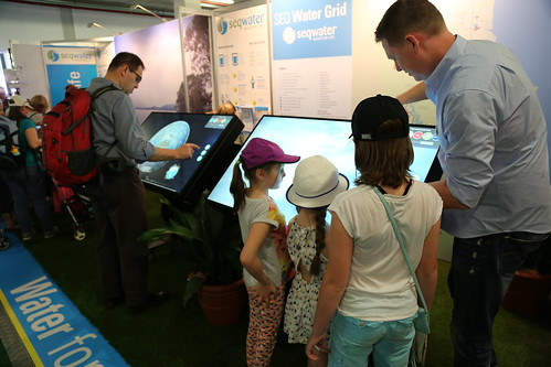 Seqwater Ekka Installation: Visitors using interactive screens
