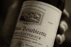 Red Red Wine. (sdupimages) Tags: 7dwf dof bouteille bottle grandcrus 1997 bordeaux vin wine hmbt mbt bokeh noirblanc nb bw sepia sépia blackwhite