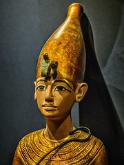 Ushabti depicting King Tutankhamun with the crown of Upper Egypt New Kingdom 18th Dynasty Egypt 1332-1323 BCE (mharrsch) Tags: figure figurine sculpture statue pharaoh king ruler tutankhamun burial tomb funerary 18thdynasty newkingdom egypt 14thcenturybce ancient discoveryofkingtut exhibit newyork mharrsch premierexhibits gold crown ushabti