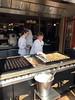 efteling_6_042 (OurTravelPics.com) Tags: efteling people making poffertjes t poffertje restaurant anton pieck plein square marerijk kingdom