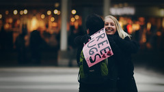 Free hugs... (*Lolly*) Tags: freehugs hugs love stockholm sweden people candid city girl canon 85mm europe bokeh