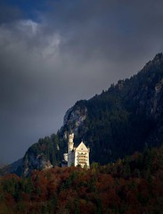 Neuschwanstein Castle (richard.scott1952) Tags: architecture building stone carving decoration scrollwork ornate solid old victorian vintage wall culture heritage history tradition royal travel tourist trip germany bavaria neuschwanstein castle view landscape scene scenic forest mountain sky cloud rock slope snow tree trees nature outdoor pretty pristine remote wild light shadow sun sunshine sunset autumn season seasonal leica m240 leicasummicron90mmf20iii