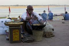 _DSC5660 (BooBoopdx) Tags: nikon d7100 afs dx 1685mm 3556 varanasi ganges color street photography india morning man sitting