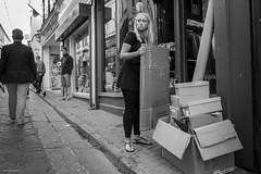 Fly Tipping (Silver Machine) Tags: stives cornwall streetphotography street candid girl standing cardboard shop blackwhite bw mono monochrome fujifilm fujifilmxt10 fujinonxf18mmf2r
