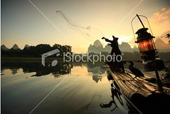 Fisherman (MPBHAIBO) Tags: china morning cloud mist mountain reflection bird water fog sunrise river landscape dawn liriver fishing fisherman asia dusk guilin yangshuo hill chinese cormorant  relaxation cloudscape stormcloud cumulonimbus  chineseculture xingping ruralscene fishingindustry   karstformation chineseethnicity woodenraft  guangxiregion