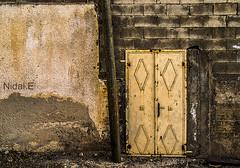 Door #2 (Nidal.Elwan) Tags: door old house art window wall israel doors palestine westbank ramallah nablus jerusalem olympus walls past zuiko israeli  kfar evolt nidal palestinian e500  kufr nidale       s95              elwan qaddum kadum  needoo77