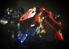Down but not Out (Omega~Charge) Tags: toys prime fight battle transformers optimus vs soundwave