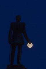 Supermoon (Tuck Happiness) Tags: moon silhouette statue night finland dark helsinki midsummer nocturnal fingers touching perigee 2013 supermoon perigeesyzygy superkuu