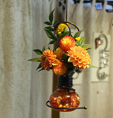Hanging flowers of autumn (byrdiegyrl) Tags: flowers vacation orange plants flower art oregon portland farmers market saturday craft september vase hanging vendor bouquet 2013 thechallengefactory