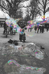 Bubble Hippy (Tom Insole Photography) Tags: street blackandwhite bw black colour tree london water photoshop canon photography blackwhite rainbow pavement path crowd performance perspective hippy bubbles competition photograph bubble performer selective selectivecolour cs6 canonphotography jubileestreet londonphotography canon40d