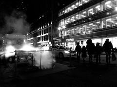 NYC Street (Matt Preston) Tags: road city newyorkcity winter urban blackandwhite bw usa newyork black cold night canon shopping dark crossing unitedstates smoke steam nighttime holdinghands grainy highiso canonpowershot payless s100 canons100