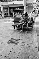 Phoning and Kissing (Pauls-Pictures) Tags: street city two people urban blackandwhite black love smile lens photography kiss kissing couple image photos candid portait pair sony streetphotography 7 kisses australia lovers perth kit 1855 alpha westernaustralia photograhy streetphotos nex streetpics streetphotograhy streetpictures sonynex7 sonyalphanex7 alphasonynex7