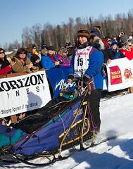Musher Michelle Phillips sets off at the start of the 2014 Iditarod (Bower Media) Tags: alaska phillips anchorage willow nome sleddog iditarod michellephillips iditarodsleddograce larrydonoso 1049miles larryadonoso photolarryadonoso