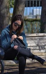 Crochet (Scott 97006) Tags: woman female lady crochet bench park shades