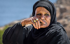 Woman with golden rings (Nadia Rifaat) Tags: woman golden rings nubia aswan egypt outdoor portrait street photography nikon d5300 18140mm