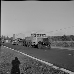 Casts a long shadow!  An ESB tractor and wide load on the Naas Road. (National Library of Ireland on The Commons) Tags: jamespo'dea o'deaphotographiccollection nationallibraryofireland esb electrictysupplyboard wideload tractorandtrailer wheelsgalore transformer naasroad dublin kildare shadow uzc805 scammelltractor generator heavyload fodentractor lowloader electricitysupplyboard shadowofaphotographer