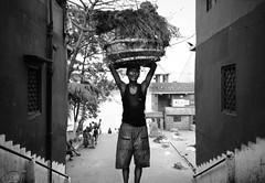 The flower seller (Street and fine art by Manobihangam) Tags: street people life kolkata india symmetry mono monochrome documentary