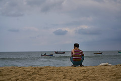 Solitude is not the same as loneliness (Gulfu) Tags: solitude loneliness beach waiting work fisherman no kerala marari moring boat fishing boats floating alone travel diaries