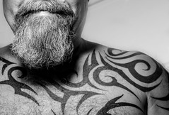 Tattooed. (CWhatPhotos) Tags: cwhatphotos olympus four thirds camera photographs photograph pics pictures pic picture image images foto fotos photography artistic that have which contain me self selfie portrait face beard bush bushy full hairy chin goatee black white mono mugshot man male tattoo tattoos tattooed tribal ink inked shoulder torso chest tatt tatts
