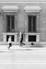 You go left and she goes right (lorenzoviolone) Tags: bw blackwhite blackandwhite finepix fujix100s fujifilm fujifilmx100s monochrome polaroid665 runner vsco vscofilm x100s ledges mirrorless sidewalk strangers streetphoto streetphotobw streetphotography tourists walk:rome=jan2017 walking windows roma lazio italy