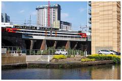 A Tram Passes A Train (jason_hindle) Tags: manchester eastmidlandsrail manchestermetrolink unitedkingdom tram manchestershipcanal train