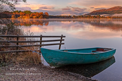 Menteith Boat (Shuggie!!) Tags: autumn boats clouds dawn fences grasses hdr hills lakeofmenteith landscape mistandfog morninglight mountains reflections scotland shoreline snow sunrise trees trossachs water zenfolio karl williams karlwilliams