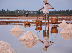 People working on salt field in Cambodia (phuong.sg@gmail.com) Tags: across agriculture aquaculture basket bear burden crops day farm farmer fields hard hardship harvest hat hot indochina industry isolated life light load ocean people pile poor road salt sea seafood shoes shoulder sky spices storage sunshine sweat sweaty thirsty unit vains vietnam vietnamese walk wander work worker