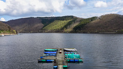 It's not the time for a cold beer yet (RIch-ART In PIXELS) Tags: rursee rurberg eifel deutschland leicadlux6 leica dlux6 germany pier boat hills hillside barrier lake water