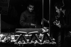 Language of the eyes / keep trying (Özgür Gürgey) Tags: 2017 50mm bw d750 darkcity sirkeci candid corn evening eyecontact grainy lowlight people street istanbul