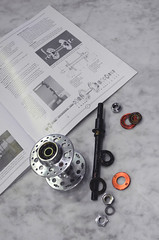 Replacing axle with quick release version (Shu-Sin) Tags: velo shusin bicycle touring randonneur randonneuse parts nomad cycles maxicar hub rear slotted spoke hole wheel building lacing freewheel axle replacement service nos bq quarterly article compass