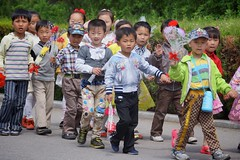 Children at Mangyongdae Native House (Joseph A Ferris III) Tags: flower children northkorea pyongyang dprk mangyongdae mangyongdaenativehouse