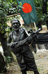 the unfinished song 2 (Durlov Nibras) Tags: sculpture music history freedom folk flag country culture du dhaka tradition patriotism countrymusic bangladesh redgreen finearts baul nationalflag dhakauniversity   dotara charukola